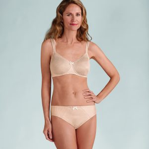 Model wearing Amoena Gracy Post-Surgery Bra in Nude Champagne Model